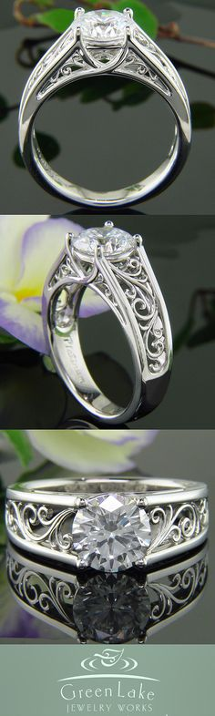 Platinum and diamond trellis mounting with delicate hand forged filigree