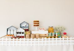 Every farm or barnyard birthday party needs a white picket fence around the food table!
