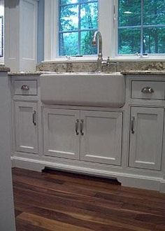 Farm house sink; furniture cabinets; gooseneck faucet