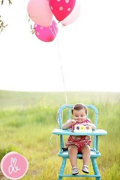 High chair with balloons.