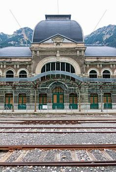 Canfranc International Railway Station (Spanish: Estación Internacional de Canfranc) is a former international railway station in the village of Canfranc in the Spanish Pyrenees, at one end of the tunnel which carried the Pau to Canfranc line under the Pyrenees. Opened in 1928, the main building is 240 meters long and has 300 windows and 156 doors.