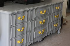 love the grey dresser, handles would be cuter in a softer yellow