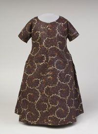 Child's Dress    Made in United States  Late 18th century    Artist/maker unknown, American    Glazed printed cotton plain weave  Center Back Length: 23 inches (58.4 cm)