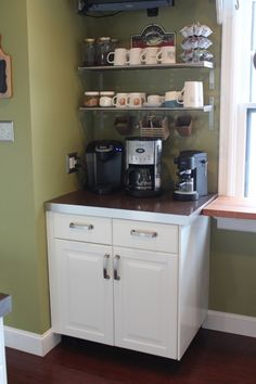 "Would love a coffee bar in my kitchen one day! This is so much more ""me"" than a wine rack..."