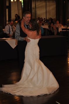 Father-Daughter Dance.  I love the way the train on the dress wraps on the floor.