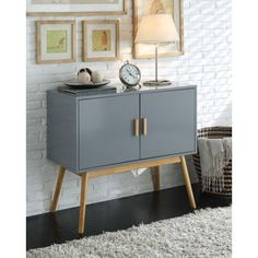$118.39   Dimensions: 31.5W x 15D x 28H in.  Convenience Concepts Oslo Storage Console Table