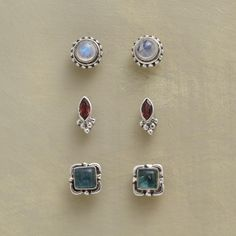 "OLD GLORY EARRING TRIO -- Iridescent white moonstones, blue apatites and red garnets grace these handmade gemstone stud earrings, each pair set in sterling silver. The set of three studs is a handcrafted exclusive. 1/4"" to 5/16""L."