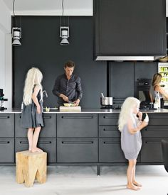 Amazing kitchen with black cabinetry and oversized drawers