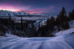 Twilight falls over Mount Moran and the Teton Range in Wyoming. The Snake River meanders through the midground. Shot this en route to WI