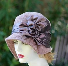 1920's flapper designer cloche hat with a turned down brim, great on a breezy fall or winter day made in a textured velvet upholstery fabric in shades of a violet/purple and chocolate brown. The hat b