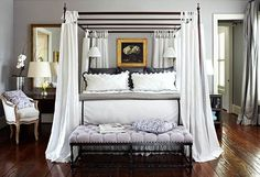 What a dreamy bedroom! Love the curtains on the bed and the pretty tufted bench. - Traditional Home