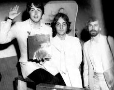 16th May 1968. John and Paul with Apple Technology founder Magic Alex as they return from New York.
