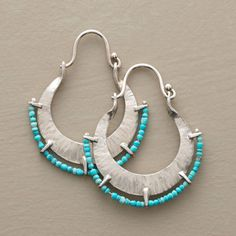 "TURQUOISE TRIMMED HOOPS -- Tipped in turquoise seed beads, Naomi Herndon's sterling silver hoops get their crinkled effect from the artist's hammer marks. Handcrafted in USA with hinged wires. Approx. 1-1/4""L."