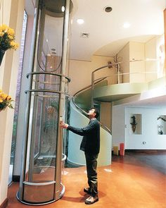 The pneumatic tube - uses air pressure to rise and flots you up and down in this $30,000 home elevator.