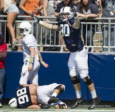 PENN STATE – FOOTBALL 2014 – BLUE/WHITE GAME, APRIL 12, 2014 – Penn State defensive end Garrett Sickels celebrates a touchdown during the annual Blue-White game, April 12, 2014, at Beaver Stadium. Joe Hermitt, PennLive