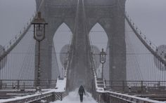 A person walks over the Brooklyn Bridge during winter storm Niko in New York City, U.S.