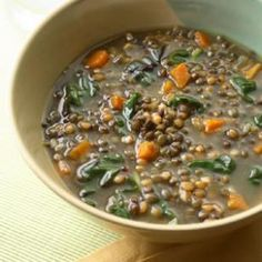 Cumin-Scented Wheat Berry-Lentil Soup Recipe: I make something a lot like this, but with kale instead of chard and lime juice instead of lemon.