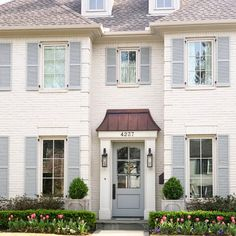 White Brick House with Light Blue Shutters Café Exterior, House Paint Exterior, Exterior House Colors, Exterior Design, Exterior Shutters, Brick Exterior Makeover, Shutters Brick House, Exterior Shutter Colors, Exterior Remodel