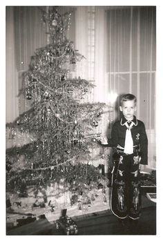 Vintage Christmas Photograph ~ John Bloodgood with his Hopalong Cassidy chaps, cap gun and wind-up metal toy tank by the Christmas tree. Vintage Christmas Photos, Xmas Photos, Retro Christmas, Vintage Holiday, Christmas Pictures, Western Christmas, Ghost Of Christmas Past, Christmas And New Year, Christmas Holidays