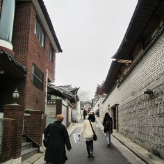 """Bukchon Hanok Village This is a Korean traditional village which shows a 600-year old urban scene that is composed of many alleys and houses called """"hanoks"""".  Today many of these hanoks operate as cultural centers, restaurants or guesthouses so tourists and locals can experience the Joseon Dynasty."""