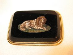 This desirable King Charles Spaniel micro mosaic brooch is unusual because it is a memorial brooch. It contains a braid of brown hair under a beveled glass locket on the reverse. The engraving is lovely, as well as the micro mosaic itself. It is inscribed PD Schenck obt 29th April 1837. Schenck is a Dutch name. There are Schenck graves in Kingston NY as well as Monmouth NJ.