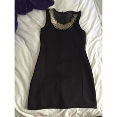 Silk black dress. Really nice on. The neckline is all silver. Barely worn. Dresses Mini