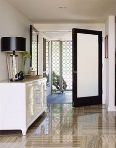 pair of doors, obscure glass, black frame. Interesting how only the doors are black, not the casing.