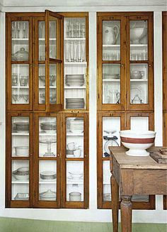 Country Living, in the home of Antiques dealer Sean Scherer, owner of New York's Kabinett and Kammer.  http://www.countryliving.com/antiques/six-new-uses-for-old-things-bookcase#slide-3