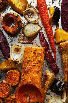 A perfect side dish for a low-key dinner, and holiday gatherings alike,  this is the simplest and prettiest thing to do with the abundance of fall  vegetables you'll be finding at the market right now. We've been testing  and prepping recipes for our annual Friendsgiving, and these roasted  veggies were too beautiful not to share ahead of time.  Keep an eye out for purple potatoes, parsnips, and all of the squash to  make it vibrant. I love the varying sizes that Robert did between the…
