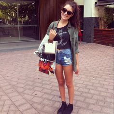 Crop Tank + Distressed High Waisted Denim Shorts + Army Green Cargo Jacket + All Black Converse