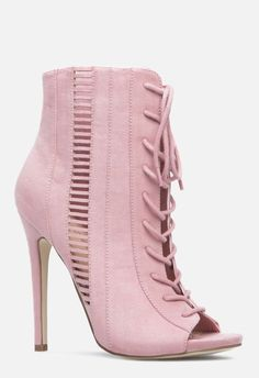 40229f444b8 Head out on the town in this dressy bootie. The opened-up style features a  peep toe