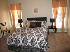 Staged Master bedroom...that's an air mattress and a shutter for a headboard.