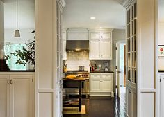 I love the fact that they took advantage of every bit of space by adding these beautiful glass front cabinets.