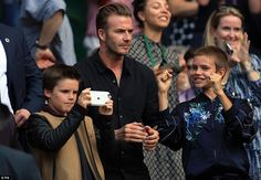 The boys later joined their father in taking pictures of the court capturing Federer's win...