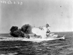 USS Texas BB-35 fires her main battery abaft the starboard beam at high elevation in 1928.