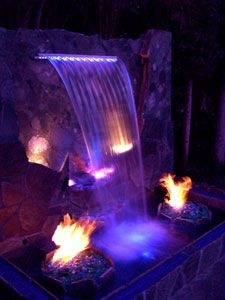 Outdoor fire pit ideas using fire glass. Modern outdooor fireplace designs using burning glass.