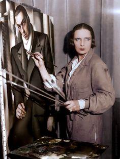 Tamara de Lempicka painting a portrait of her first husband Tadeusz Lempicki, c.1928. Photographer: Thérèse Bonney; colorized by painters-in-color