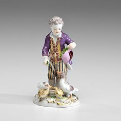 German, 19th century. Meissen figural group of a young boy in 18th century attire feeding a family of geese. Marked on bottom for Meissen, as well as C41 / 132