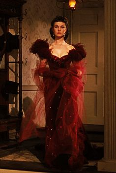 """Scarlett O'Hara Red Velvet """"Harlot"""" Dress worn to Ashley's birthday party. Film designer Walter Plunkett spent months studying historical societies and private collections for costumes pieces from the Civil War period. This is one of the most beloved dresses from the movie."""