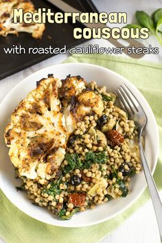 Mediterranean couscous with artichokes and sun-dried tomatoes - served with tasty roasted cauliflower steaks. Vegetarian, vegan, full of flavour!
