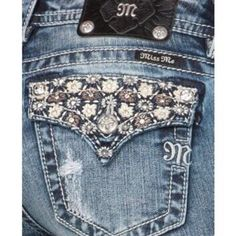 """Daisy Dream Bootcut Miss Me's  Brand New Flattering Miss Me Bootcut Jeans with Adorable and Eye Catching Daisy Rhinestone and Leather Embellishment!  Feminine and Edgy like only Miss Me can Offer! Perfect for Spring! Style MP7503 Color Med 172 Inseam 34"""" Rise 8.5"""" Miss Me Jeans"""