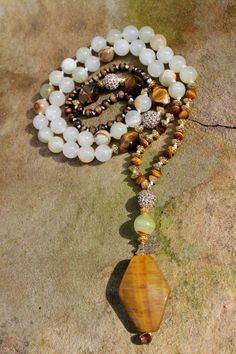 Hey, I found this really awesome Etsy listing at https://www.etsy.com/listing/220620141/long-beaded-necklace-hand-knotted-multi