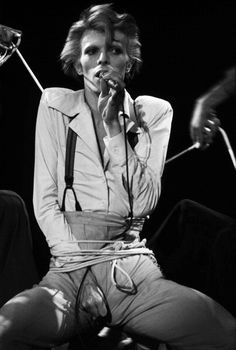 Bowie at the Universal Amphitheatre, Los Angeles 1974. Diamond Dogs tour; performing Big Brother. Photo by Terry O'Neill
