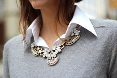 Crisp white shirt, solid sweater, ornate collar necklace