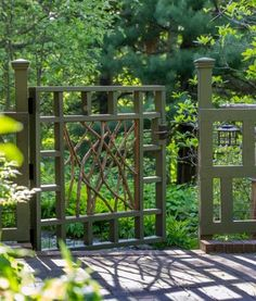 Gates marry rustic twig-work to a rectilinear frame painted mossy green. Photos by Rob Cardillo