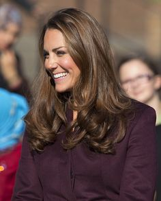The look that has become Kate's signature style, her hair was down and perfectly curled during a visit to a community garden project in October 2012. via @stylelist | http://aol.it/1ALcdcu