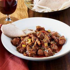 lamb cubed, red wine, berbere, yellow pepper | Ethiopian Spiced Lamb Stew Recipe - Delish.com