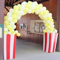Circus Popcorn Balloon Arch by Inflation Sensations: Circarnival Wedding Details | Vintage Circus Carnival Wedding on a Budget | Lola Tangled blog