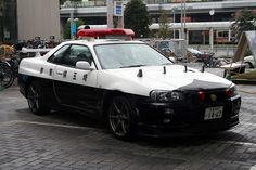 Japanese NISSAN SkylineR34 GTR police car - Black and white (police vehicle) - Wikipedia, the free encyclopedia
