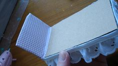 """Making a bed for my """"ShoeBox dollhouse"""".  Step 3 Cover the """"headboard"""" with fabric (also cover the part of the bed the doll lays on)."""